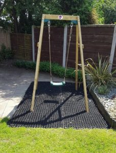 Rubber Grass Mats Under A Swing