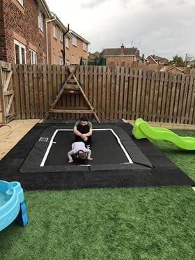 Rubber Play Tiles Used Around A Built In Garden Trampoline: The Conclusion