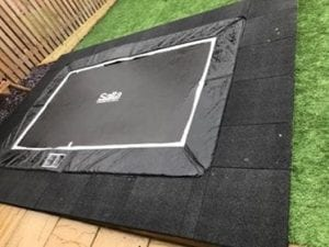 Rubber Play Tiles Used Around A Built In Garden Trampoline: The Work