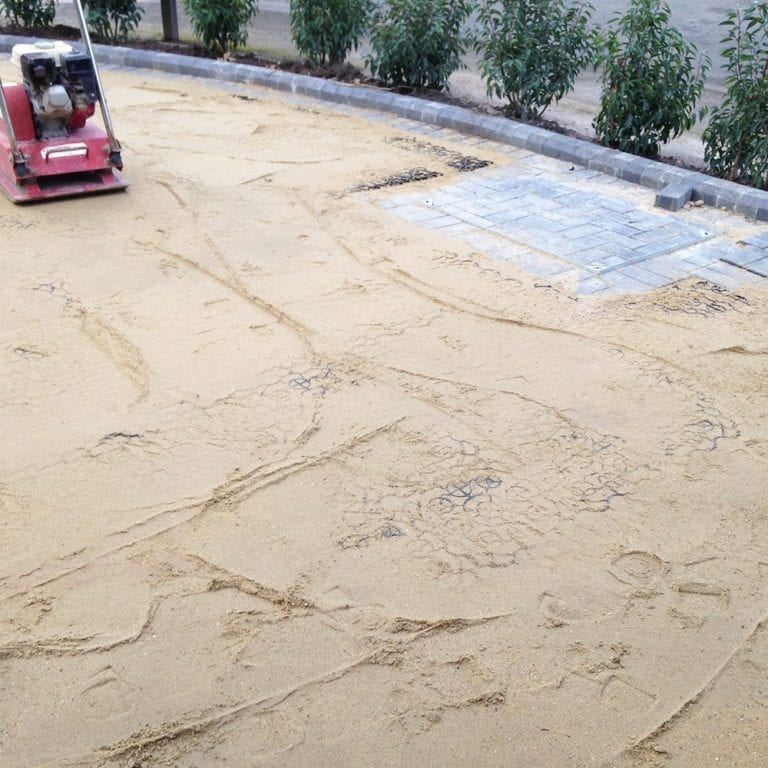 Compacting X-Grid & Laying Artificial Grass