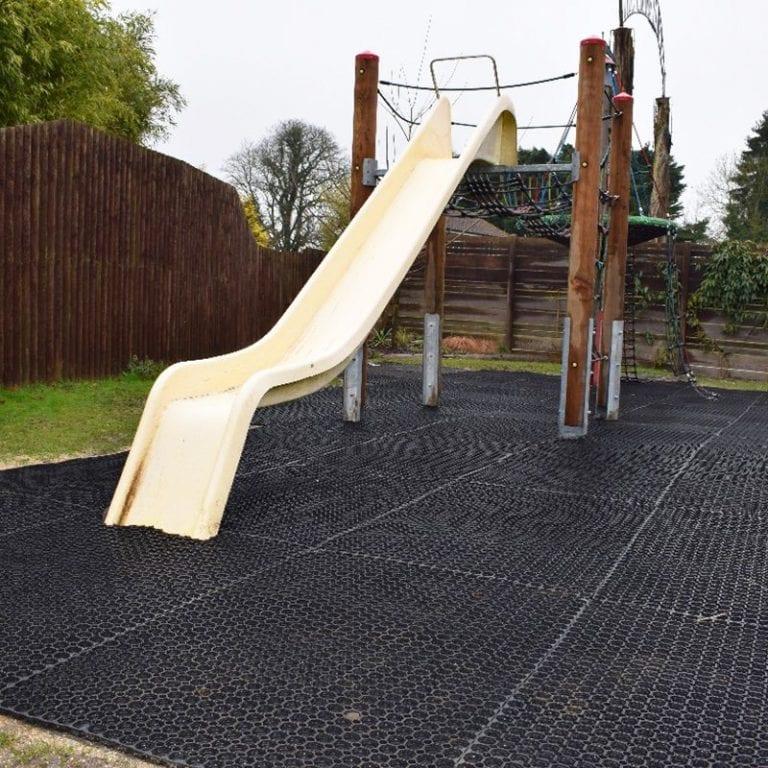 Using Rubber Grass Mats Under A Play Area: Work