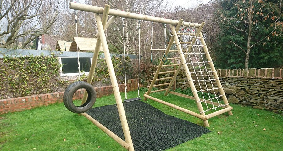 Rubber Grass Mats Installed Under A Caledonia Play Swing Set - Featured Image