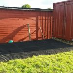 Grass Mats Behind Shipping Container In Horse Paddock - Featured Image